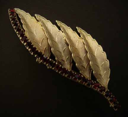 gold tone leaves and faux ruby stones brooch pin